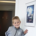 Jaimy at the Expo next to his picture